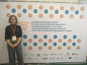 [Translate to Русский:] Dr Anna Kushnir near the brandwall of the Conference